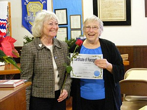 NANCY SLAGLE (left) is recognized for her first year as a Parkdale Grange member by her sister Mary Parrott on Saturday, Dec. 7, at the 100th Anniversary Open House at the Grange Hall.