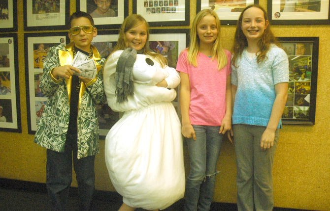 The Runaway Snowman will premier with two free showings Monday, Dec. 16, at 12:20 and 7 p.m. at Dry Hollow Elementary School in The Dalles. Pictured above, from left, Taylor Beeks plays Freddy Fasttalk, Rachel Smith plays Happy, Makenzie Gardner plays Mrs. Hill and Zora Richardson plays Robin.