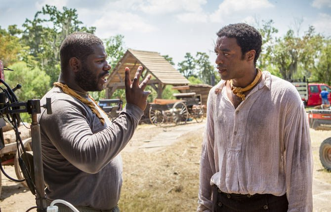 "Director Steve McQueen, left, and actor Chiwetel Ejiofor during the filming of ""12 Years A Slave."""