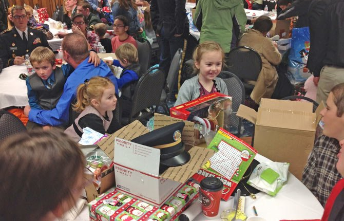 OREGON NATIONAL Guard's Alpha Company 3-116 Cavalry, based in The Dalles, celebrated Christmas Dec. 7 with a party at the Shilo Inn catered by the Portage Grill. In attendance were 49 families with children and a total of 127 soldiers. Only two families were unable to attend due to snowy weather. 