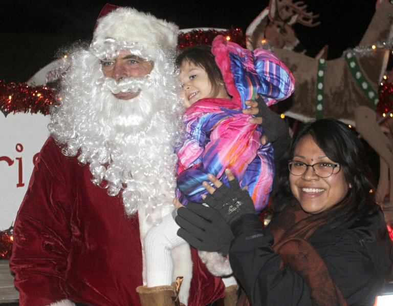 Santa Claus (Don Burford) visited North Omak neighborhoods Tuesday night handing out candy canes, listening to Christmas wishes and collecting donations for area food banks.