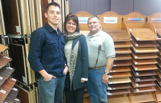 MARCUS DENNEY, left, will become the second generation at Gary Denney Floor Covering, taking over the 37-year-old business from parents Wendy and Gary Denney.