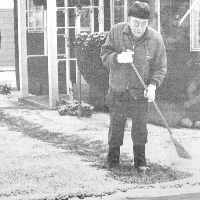1983: Mike Burke was among Sunnyside's residents clearing paths through the season's first snow.