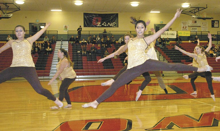 """Nutcracker"" cast members perform during halftime of the Liberty Bell at Omak basketball game Thursday. The ballet opens at 7 tonight, Friday, in the Omak Performing Arts Center, 14 S. Cedar St. Performances continue through Sunday, with shows at 1 p.m. and 7 p.m. Saturday and 3 p.m. Sunday."