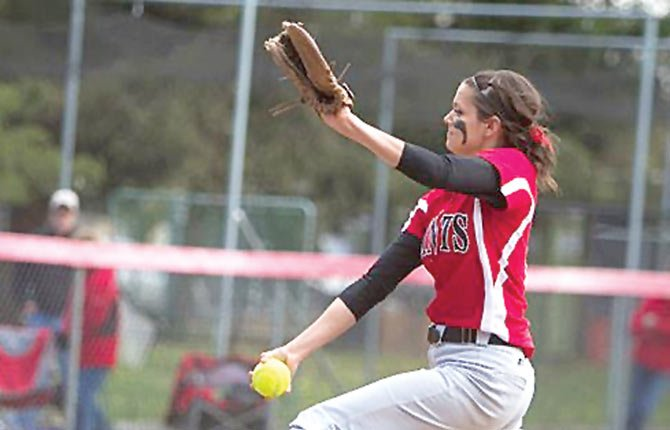 MOUNT HOOD Community College pitcher Ann Marie Guischer winds up for a pitch during NAIA action earlier this season. Guischer recently accepted a scholarship offer to play at the Oregon Institute of Technology.