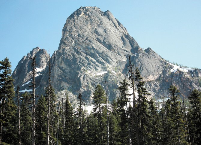 Liberty Bell Mountain was carved out by erosion. Once upon a time people believed it had always been exactly like this. But even in our lifetimes the trees around it have changed.