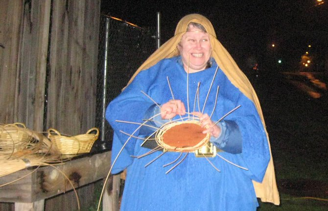 "BONNIE PARRIES, A resident of ""Bethlehem,"" weaves a basket during an earlier performance of Wishram's live nativity. This year the Christmas scene will operate Friday, Saturday and Sunday, Dec. 20 to 22, from 6 to 8 p.m.	Contributed photo"