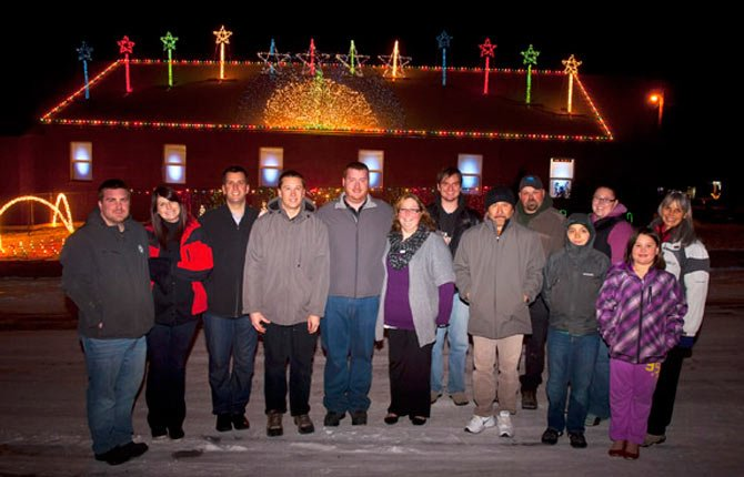 Volunteers who worked on the Church of the Nazarene lighting display included, from left, Pete Hall, Melanie Hall, Pastor Aaron Mednansky, Kris Langdon, Adam Gietl, Michelle Cochran, Judah Harwood, Ino Olivan, Raymond Kimball, Angel Garcia, Kim Wadsworth, Leaveny Wadsworth and Ramona Harwood. Not pictured are Brittany and John Bernstein, Luke Maney, Russ Erlenbush, Brian Fix, Steven Zack, Adam Pratl, Mychal and Tobin Hall.