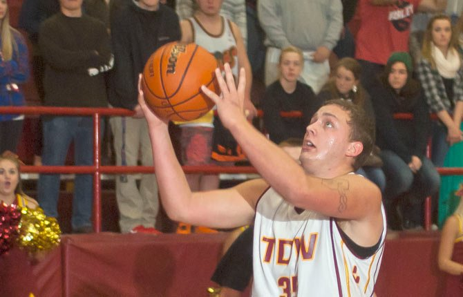 The Dalles Wahtonka senior forward Chaise Shroll goes up for two points as The Dalles Wahtonka struggles against St. Helens in the first quarter of Friday's non-league hoops matchup in The Dalles. The visiting Lions sank seven 3-pointers and had eight players hit the scoresheet in their 64-43 win.