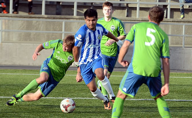 SO SAMBA team member Felipe Heredia challenges a player from the Seattle Sounders U18 team in a recent game at the Sounders' training facility. SO Samba FC is a recently formed semi-pro team based out of Hood River.