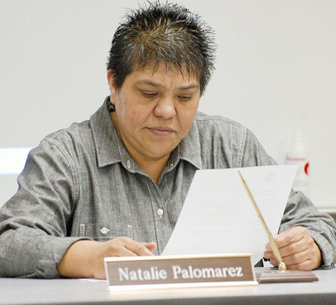 Mabton School Board Director Natalie Palomarez looks through paperwork during last night's school board meeting.