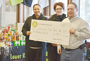 The culmination of a three-month effort on behalf of the local Sunrise Outreach food bank resulted in a presentation of $500 from the Noon Rotary