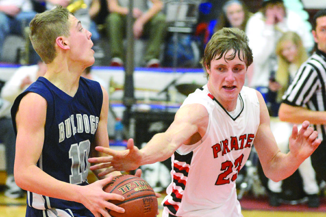 Prairie's Lucas Arnzen used every bit of his long reach to deflect the ball away from Grangeville's Austin Parks a beat before Parks could put up a shot attempt at the conclusion of a fast break during the Idaho County Shootout last Friday night, Dec. 13.