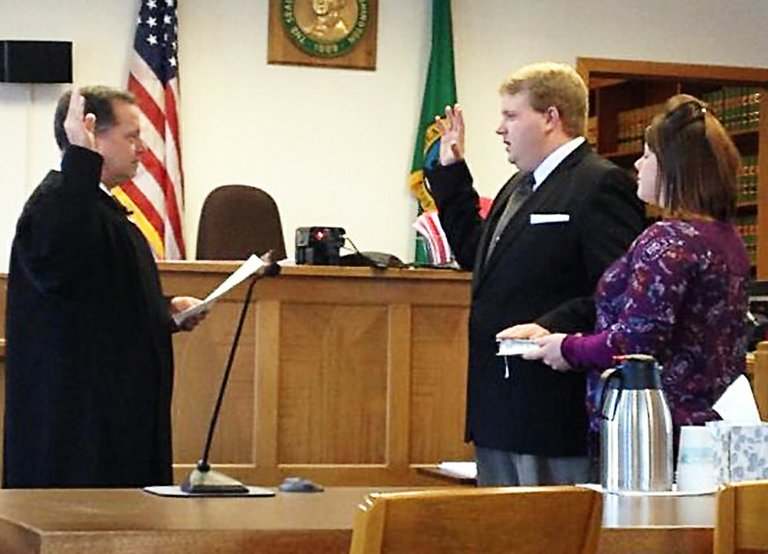 Brian Dansel, center, is sworn in as the new 7th Legislative District senator during a Dec. 6 ceremony in his hometown of Republic.