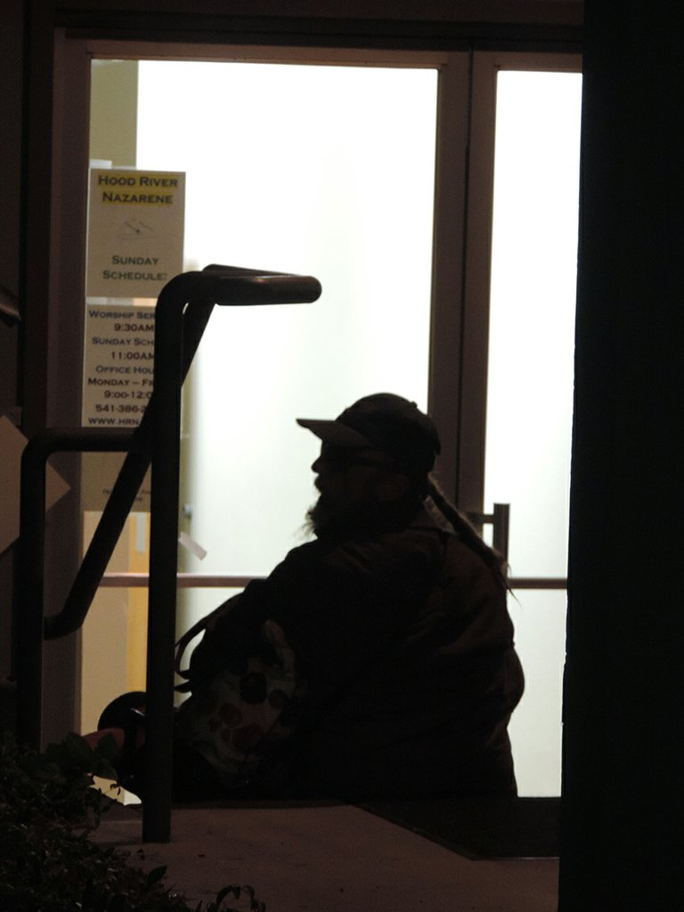 A man waits outside the warming shelter.