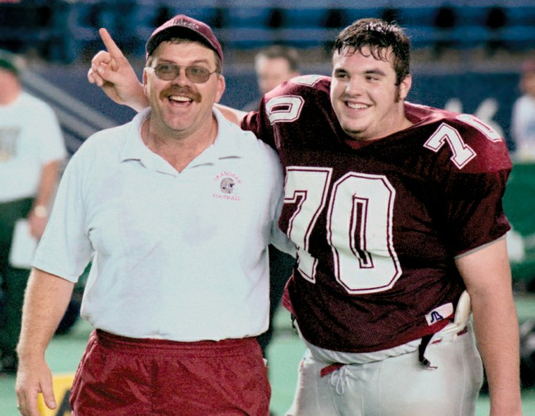 Denny Neely, left, and son Tyler after Okanogan won the state championship in 1999.