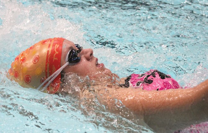 THE DALLES WAHTONKA swimmer Allie Wood runs through the water in her backstroke event at a meet in Newport earlier in her career. Last weekend, Wood and the Eagle Indians secured 15 top-3 performances and added six first-place outcomes, including both the boys' and girls' relay rallies.