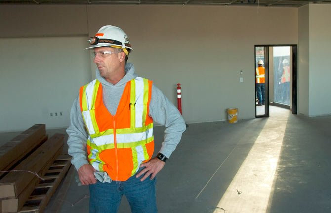 Greg Garske, superintendent of Hoffman Construction, the primary contractor of the project, answers questions during a tour of The Dalles National Guard Armory. The project is near completion, and is expected to be open for use this spring.