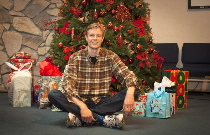 TIM VANCE, associate pastor of Gateway Presbyterian Church, sits in front of a Christmas tree at the church, where he teaches a class, Christmas Unplugged, about creating space in life for a happier Christmas.