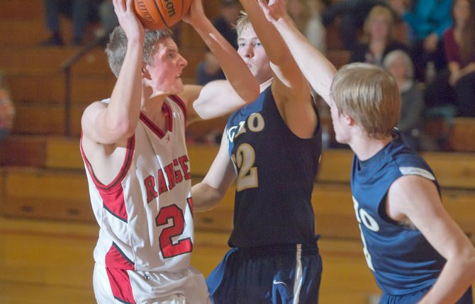 Dufur junior Jake Kortge, left, is fouled as he goes to the basket in Friday's game against Echo in Dufur. Kortge and teammate Caleb Morris combined for 29 points on 10 of 20 shooting from the floor, 10 rebounds and six steals to lead the Ranger boy's basketball squad to an easy 58-21 win over Echo.