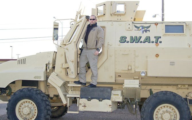 Grandview Police Department's new assistant police chief, Mike Hopp, poses with the city's new SWAT vehicle. Hopp has been with the department for more than 12 years and said he plans to spend his entire career in Grandview.