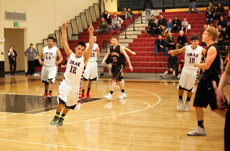 Leighton Boyd, No. 12, celebrates Omak's 57-53 victory over Cashmere on Saturday.