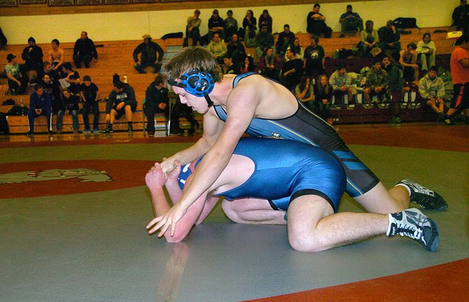 Lucas Vugteveen of Tonasket strains again Zach Hill of Wilbur-Creston-Keller during 182-pound match Saturday at the Okanogan Invitational wrestling tournament.
