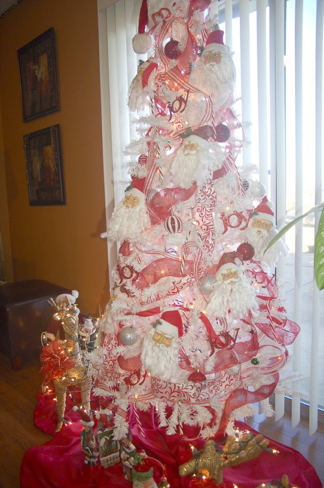 Santas, reindeer, candy canes and many shades of pink give this tree its name – the Peppermint Tree.