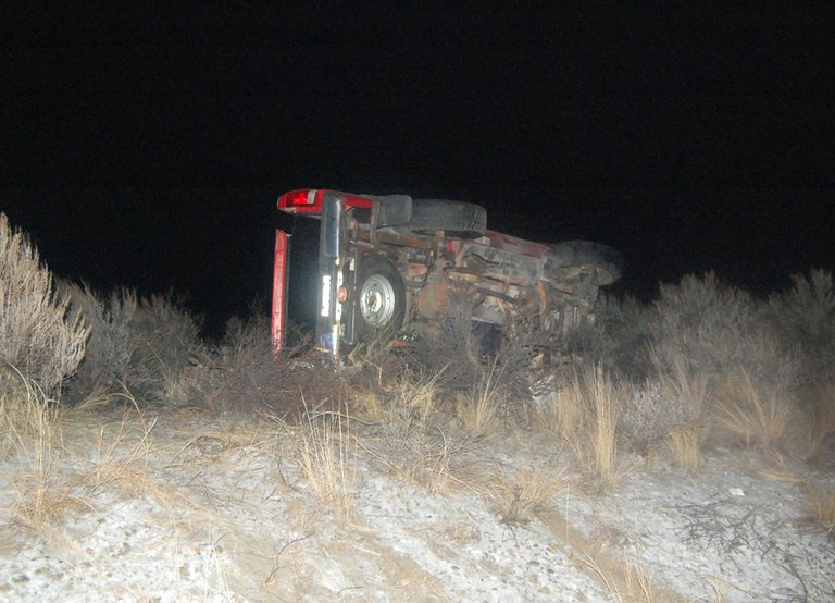 This truck overturned Monday night when sudden snow showers caused slippery driving conditions. Jennifer Marshall.