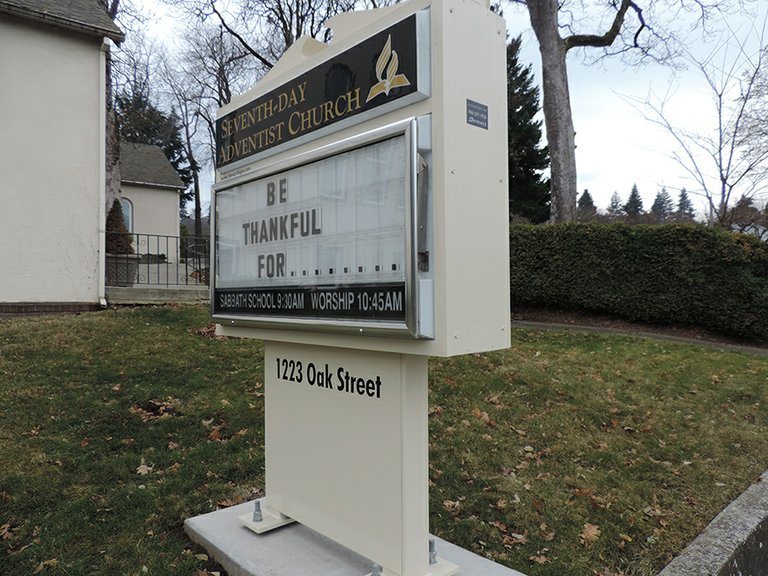 SEVENTH-DAY ADVENTIST, on Oak Street, added a sign board in September.