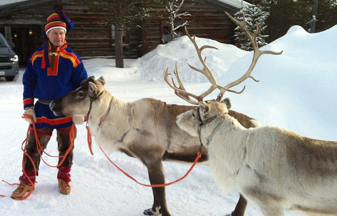In this March 2013 photo, A Sami handler in traditional clothing holds two of his herd in Saariselka, Finnish Lapland. Reindeer are featured on Christmas cards and in movies worldwide this time of year, galloping across the sky with Santa's sleigh in tow. But on Europe's northern fringe, the migratory mammals are part of everyday life all year round as they roam the fells of Lapland - the Arctic homeland of the indigenous Sami people of Norway, Sweden, Finland and northwest Russia.