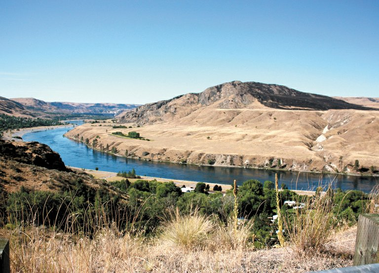 Architect of erosion, water remodels constantly. This is the Columbia River a few miles north of Chelan.