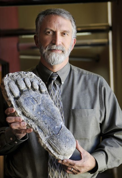 DR. JEFF MELDRUM poses with a purported Sasquatch footprint. Meldrum will be one of the speakers at the Sasquatch Revealed exhibit opening day activities at the Columbia Gorge Discovery Center.