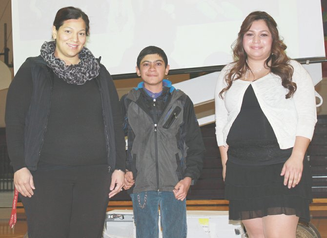 Mabton student Jesus Policarpo is the winner of a computer tablet after submitting an essay about challenges he has faced to obtain an education. His story, as well as the stories of Irma Mejia (left) and Elizabeth Garcia (right), were shared at a recent career fair.