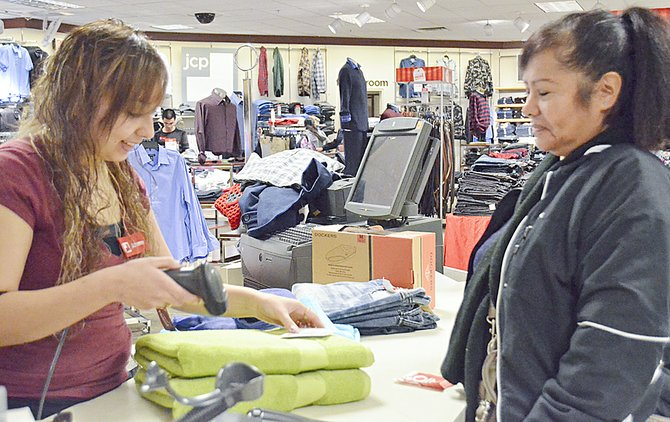The gifts received on Christmas day aren't always the perfect fit or color. That's why some shoppers, like Rosa Sandoval (right), ventured out Thursday exchanging gifts at retail locations like Sunnyside's JC Penney store. Sandoval received a towel with a flaw and JC Penney Associate Carmela Ayala gladly completes the exchange.