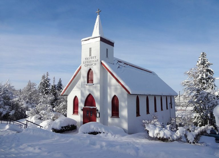 Trinity Lutheran Church on Mill Street in Grangeville was caught here on a perfect snowy path against blue skies.