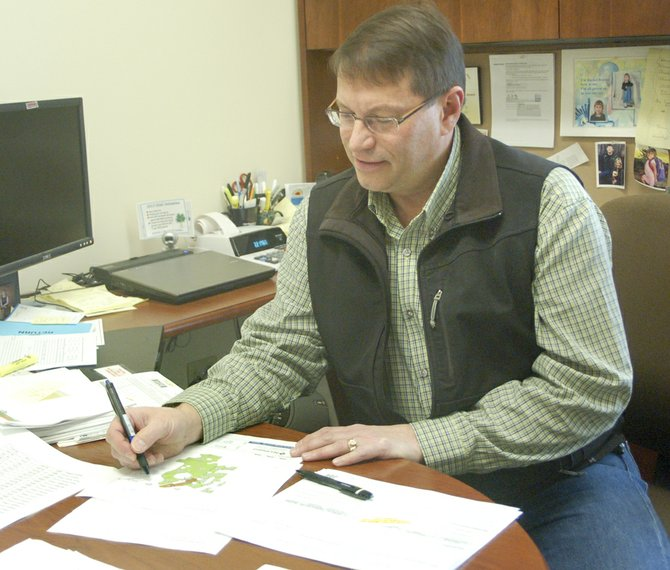 Gary Olson puts his years of expertise to work studying Lower Valley crop production histories as part of his job as a crop insurance agent with Northwest Farm Credit Services. He has been with the Sunnyside company since 2003.