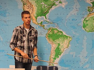 Leo Dorich, 2010 HRVHS grad, spent two days before the winter break visiting his former teachers' classrooms and talking to current teachers about his Semester at Sea experiences. Here, Dorich stands in front of a world map while talking to Heidi Mudry's Spanish class.