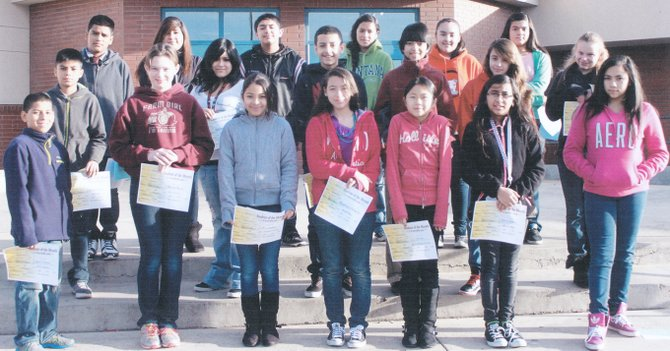 Sunnyside's Harrison Middle School students of the month for December are (front row L-R) Isaiah Cienfuegos, Marlee Weets, Rosa Benitez, Rosalinda Palencia, Lily Froese, Daisy Espinoza and Angie Gudino; (second row L-R) Cristian Ruldo, Kassandra Castilla, Carlos Chavez, Brian Licona, Susana Munoz and Chastity Collyer; (back row L-R) Israel Tavira, Esperanza Lopez, Jaylen Navarro, Miriam Galvan, Vanessa Guerrero and Lizbeth Cisneros. Not pictured is Roberto Rivas.