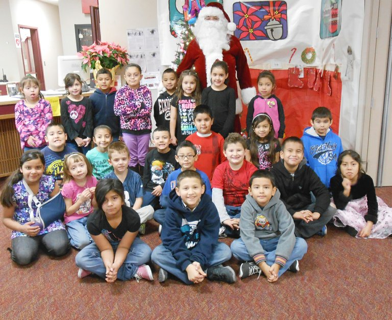 Sunnyside's Washington Elementary School first and second grade students of the month for December as listed by school staff are (front row L-R) Vannessa Montoya, Aaron Vargas and Tony Gutierrez; (second row L-R) Maya Estrada, Dulce Gomez-Diaz, Richard Diaz-Berber, Angel Ledezma, Carter Hauver, Angel Lopez and Irene Ramos; (third row L-R) Aiden Nonato, Jocelyn Mendoza, Damien Saenz-Garcia, Alejandro Vargas, Natali Perez and Jedidiah Perez; (back row L-R) Marisol Noriega-Valdez, Julianna Rodriguez, David Puga, Marisol Perez, Favian Rosas, Emily Gallardo, Galilea Gutierrez and Marveia Lopez. Not pictured are Valerie Valdez, Christopher Moreno and Julian Ramirez.