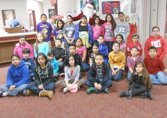Sunnyside's Washington Elementary School third, fourth and fifth grade students of the month for December as listed by school staff are (front row L-R) Maida Delgado, Estrella Carrillo, Eliza Cisneros, Dominique Booth and Aneesa Ortega; (second row L-R) Adam Ruiz, Lilliana Estrada, Juan Leyva-Hernandez, Jennifer Roldan, Alexis Daniels, Mariah Balli and Hugo Martinez; (third row L-R) Elizabeth Alvarez, Lily Potter, Xavier Randall, Cecilia Alvarez, E.J. Villanueva, Alani Loya, Selene Rojas and Nadia Bucio; (back row L-R) Alex Mojica, Nicole Miranda-Vargas, Perla Flores, Sarai Rodriguez, Trishelle Fernandez, Stephanie Ruelas and Raul Garcia. Not pictured is Josiah Rosalez.