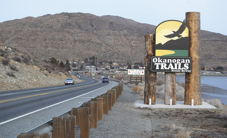 A new sign leading into Pateros beckons drivers to follow the Okanogan Trails Scenic Byway along U.S. Highway 97 to Oroville.