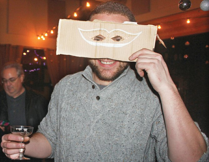 SweetRivery Bakery's Alex Hymer celebrates New Year's Eve at the inaugural Masquerade Ball at The Central Building shortly after midnight Jan. 1. The event was hosted by Rivers Restaurant and Pateros Lakeshore Inn.