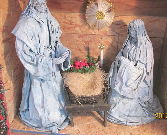 A one-of-a-kind baby Jesus figurine was stolen from the manger scene near the front door of George and Carol Johnson's home. The baby Jesus, Mary and Joseph statues were made by Carol using cloth dipped in glue and then formed into the figures. She applied an exterior finish to give the miniature figurines a metallic or pewter appearance. The Johnsons are hopeful the thief or thieves will return the small statue.