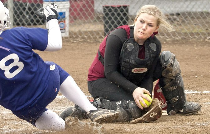 TDW softball player Katherine Kramer awaits a collision at the plate in The Dalles. Kramer accepted a scholarship to play at the University of Pittsburgh.
