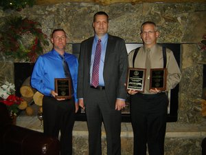 RESERVE DEPUTY Mike Renault andMarine Deputy Mike Anderson of the Hood River County Sheriff's Officepose with Sheriff Matt English (center) during the OSMB award banquet held last month in Bend. Both received life saving awards for a July river rescue.