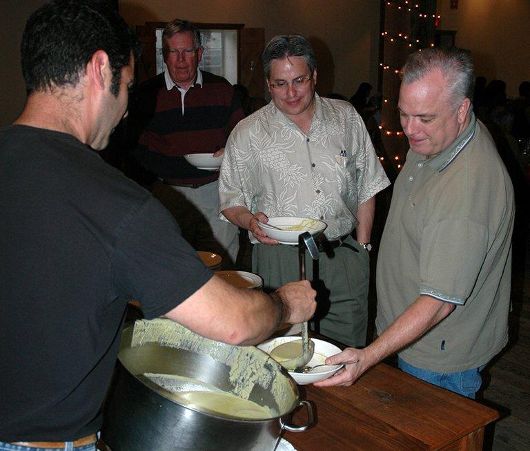 CHEF Ben Stenn serves soup at the original Gorge Kids Soup, as supporters await refills.