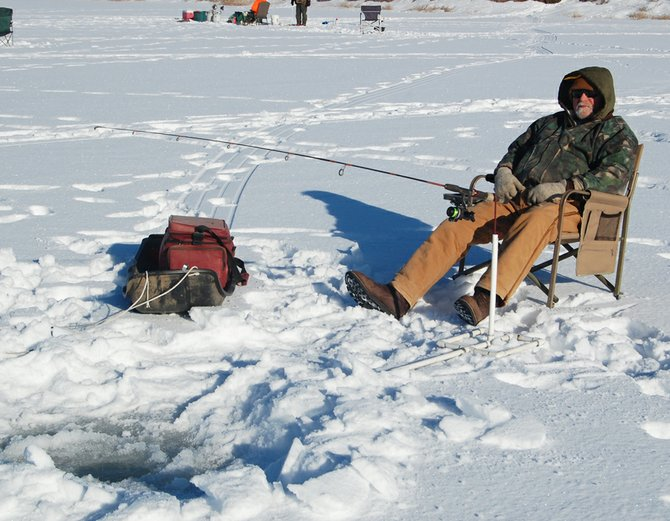 A fisherman tries his luck on the thick ice of Sidley Lake.