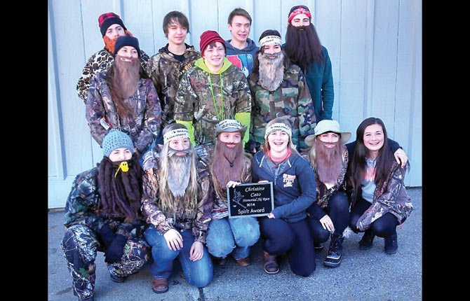 "MEMBERS OF THE Dalles Wahtonka ski team are dressed in ""Duck Dynasty"" mode during the Christine Cato Memorial Event Saturday at Mount Hood Meadows. The team had good finishes and took home the coveted spirit award."