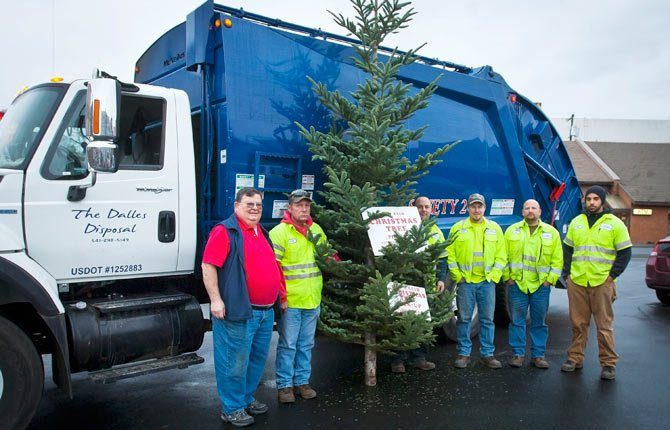 The Dalles Lions Club members, working with The Dalles Disposal, will be picking up Christmas trees Saturday, Jan. 11, for disposal. Disposal donations will raise money to support various services and projects of The Dalles Lions Club. The program started in 1973, raising $2,600 last year and $64,000 since 1973. To dispose of your tree, simply leave it at the curb by 9 a.m. Lion's Club members will knock on doors to ask for donations, or leave a donation envelope when occupants aren't home. Pictured, left to right, are program founder Bill Hamilton of The Lions Club and The Dalles Disposal drivers Rusty Johnson, Rocky Linebarger, Robert Shuman, Ken Hageman and Nick Loudd.